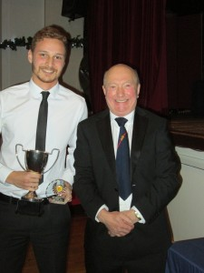 Anthony Burbury receives Fielder of the Year 2016 from Vice President Rodney Bottle