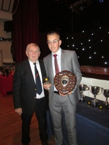 Owen Harrison receives the Young Player of the Year 2016 from Vice President Michael Lidstone