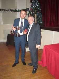 Owen Harrison receives the 2017 Best Bowling Performance from Vice President Warwick Stevens