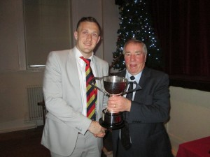 Michael Neame receives the 2018 Best Bowling Performance Award from Vice President Warwick Stevens