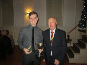 Daniel Gunner receives the 2018 Fielder's Award from Vice President Rodney Bottle