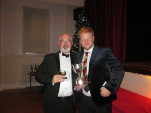 Brian Carey receives the 2018 Sunday XI team award on behalf of Tom Carey from Sunday Captain James Sutton