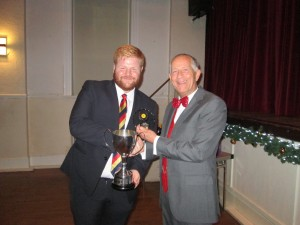 James Sutton receives the 2019 Batting Performance (111 no) from Vice President Rodney Jacks