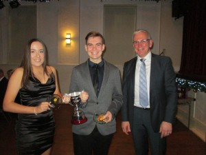 Ella Hadler and Daniel Gunner receiving the Inaugural Kenny Hart Cup's Young Performance of the Year  from Kenny's son Darren - Ella and Daniel scored their maiden half centuries while putting on 100 run partnership and winning the game off the last ball of the match