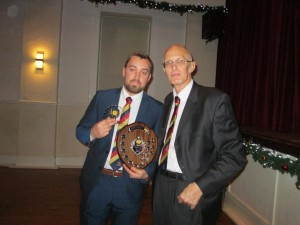 Owen Harrison receives the Bowling Award for 2019 (36 wickets) from Committee Member Barry Wood