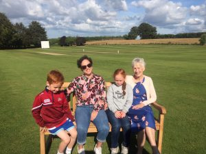 Jenny and Victoria Lincoln with Roy's grandchildren on the Memorial Bench presented by members of the Club in memory of Roy